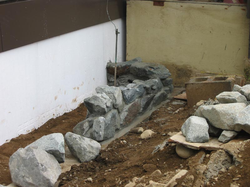 Stone retaining wall for Rock wall insulation